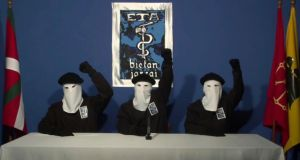Masked members of the Basque separatist group Eta hold up their fists in unison in this 2011 file photograph taken at an unknown location. Photograph: AP Photo/Gara via AP