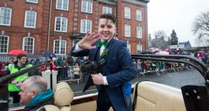 Fourteen-year-old Limerick person of the year and cyberbullying campaigner Luke Culhane leads the annual St Patrick's Day parade in Limerick. Photograph:  Sean Curtin/True Media.