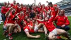 Cuala's players and management celebrate their All-Ireland Senior Club Hurling Championship Final win over Ballyea at Croke Park. Photograph: Tommy Dickson/Inpho