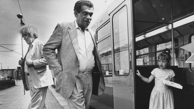 Derek Walcott with Seamus Heaney and Rebecca O'Neill-Doran from Bray, Co Wicklow, at the launch of a series of poetry cards on the Dart in 1989. Photograph: Matt Kavanagh/The Irish Times