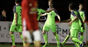 Ireland Under-17's striker Glen McAuley  celebrates scoring a goal for Liverpool Under-18s: McAuley's strike  against Slovakia  sees Ireland qualify for the European Championships. Photograph:  Martin Rickett/PA Wire