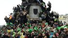 People watch the St Patrick's Day parade in Dublin, Ireland. Photograph: Clodagh Kilcoyne/Reuters