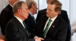 Former mayor of New York Michael Bloomberg speaks to Enda Kenny before the Taoiseach addressed staff at the Bloomberg headquarters in New York on Friday. Photograph: Niall Carson/PA Wire