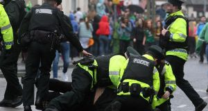 Police arrest a man in the  Holyland area of Belfast during the St Patrick's Day celebrations. Low-level disorder, alcohol-related offences and minor assaults were among what young people were arrested for.  Photograph:  Freddie Parkinson/Press Eye
