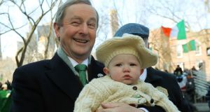 Taoiseach Enda Kenny holding seven-month-old Savannah Marie during the St Patrick's Day parade in New York. Photograph: Niall Carson/PA Wire