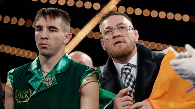 Conor McGregor joined Conlan for the ring walk and was in his corner for the fight. Photo: Frank Franklin II/AP Photo