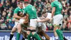 England's Billy Vunipola is held up by the Irish forwards. Photograph: Inpho