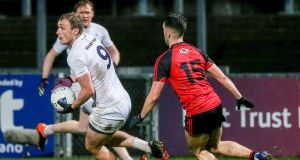 Kildare's Tommy Moolick and Down's Ryan Johnston. Photograph: Philip Magowan/Inpho
