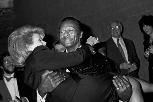 Chuck Berry carries comedian Joan Rivers at the D.W. Griffith Awards at the  Lincoln Center, New York,  in February 1988. Photograph: Ron Galella/WireImage