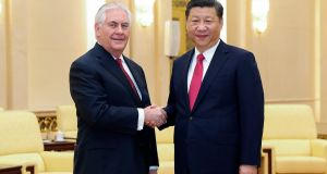 US secretary of state  Rex Tillerson, left, shakes hands with China's president Xi Jinping at the Great Hall of the People in Beijing, China on Sunday. Photograph: AP