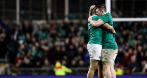 Simon Zebo and man of the match Peter O'Mahony celebrate after Ireland's 13-9 win over England. Photograph: Tommy Dickson/Inpho