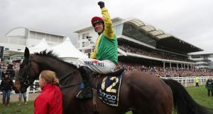 Jockey Robbie Power celebrates after his winning ride on Sizing John in the  Gold Cup Chase  at Cheltenham Racecourse. Henry De Bromhead, the horse's former trainer,  congratulated Sizing John's new trainer Jessica Harrington on her success. Photograph: David Davies/PA Wire