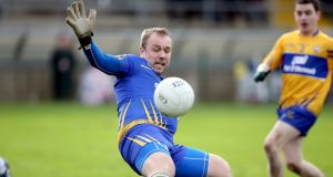 Clare goalkeeper Joe Hayes makes a good save to deny Sean Quigley a goal at Brewster Park on Sunday. Photograph: Inpho