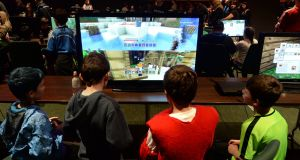 Young gamers at GamerCon, in the Convention Centre in Dublin. Photograph: Dara Mac Dónaill