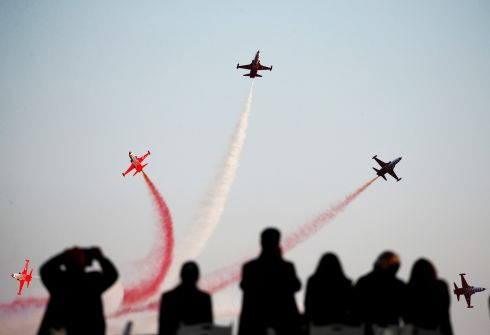AIR ACES: The Turkish Stars aerobatic team fly their Northrop F-5 Freedom Fighters over a Turkish memorial during a ceremony to mark the BAttle of Gallipoli. Photograph: Reuters