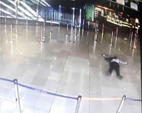 TERROR ATTACK: An airport CCTV screen image shows a man on the ground inside Orly Sud terminal following a shooting incident at Orly Airport near Paris. Photograph: Reuters
