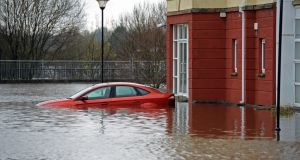 A flooded car and house  in Carrick-on-Shannon, Co Leitrim, in December 2015.  Photograph: Eric Luke