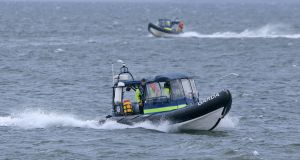 Members of the Garda Underwater Unit and the Coastguard leave Blacksod  as part of the search. Photograph: Colin Keegan, Collins Dublin.