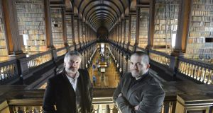 High art or pulp fiction?: thriller writer John Connolly and Trinity College Dublin academic Brian Cliff, organisers of a crime writing festival there in 2013. Photograph: Alan Betson