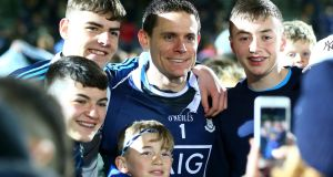 Dublin goalkeeper Stephen Cluxton poses from photographs with supporters after their draw with Kerry which saw them equal the Kingdom's unbeaten record. Photo: Cathal Noonan/Inpho