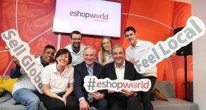 Minister for Education and Skills Richard Bruton with eShopWorld CEO Tommy Kelly and team members at the firm's new global HQ in Swords. Photograph:  Jason Clarke
