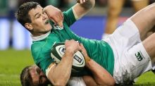 Johnny Sexton is tackled by England's Owen Farrell  at the  Aviva Stadium. Photograph: Billy Stickland/Inpho