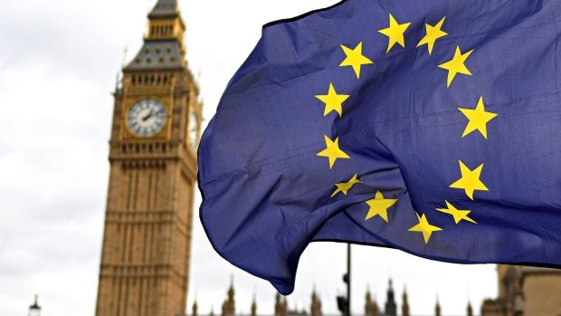 The EU flag flies in front of the British parliament. File photograph: Andy Rain/EPA