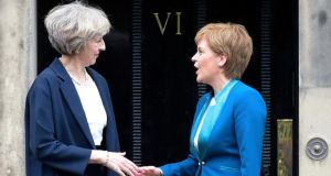 British prime minister Theresa May and  Scotland's first minister Nicola Sturgeon in July 2016.  The Scottish parliament will on Tuesday begin debating a motion calling for a second referendum on independence to be held between autumn 2018 and spring 2019. Photograph: Lesley Martin/AFP/Getty Images