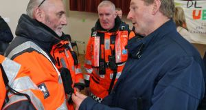 Taoiseach Enda Kenny is briefed by Tom Doyle of Westport Coastguard about the search for Rescue 116 during a visit to Blacksod, Co Mayo. Photograph: Colin Keegan, Collins