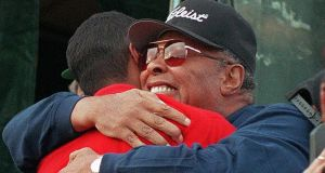 Earl Woods hugs his son after his record brekaing win. Photo: Bob Pearson/Getty Images