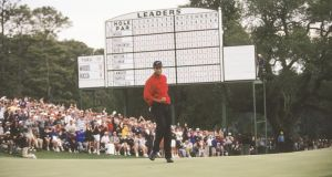 Woods holes a putt during the final round of the 1997 Masters. Photo: Sam Greenwood/PGA TOUR Archive