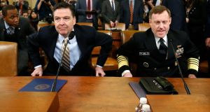 FBI director James Comey and NSA director Mike Rogers take their seats at a hearing into alleged Russian meddling in the 2016 US election, on Capitol Hill in Washington, DC. Photograph: Joshua Roberts/Reuters