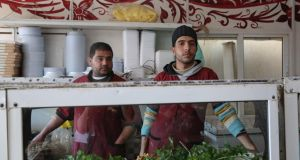 Mohammad and a colleague in the falafel restaurant where they work in Zaatari refugee camp. Photograph: Sally Hayden