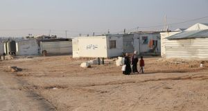 Women walk through Zaatari refugee camp in Jordan, currently home to 80,000 Syrian refugees. Photograph: Sally Hayden