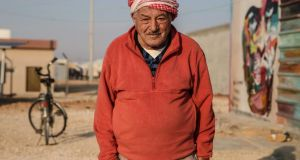 An old man poses in Zaatari refugee camp in Jordan, currently home to 80,000 Syrian refugees. Photograph: Sally Hayden