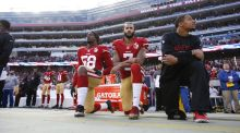 Eli Harold, Colin Kaepernick and Eric Reid kneel on the sideline during the anthem at Levi Stadium on January 1st. Photograph: Getty Images
