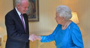 The Queen is to send a private message to Martin McGuinness's widow Bernie following the death of the former Northern Ireland deputy first minister. Mr McGuinness and the Queen met in 2012 and (above) in 2014, an event which would once have been unimaginable. Photograph: AFP