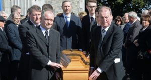 Haughey family members including Seán Haughey (left) and Ciarán Haughey (right) escort the remains of Maureen Haughey at her funeral at Malahide, Co Dublin. Photograph: Eric Luke/ The Irish Times