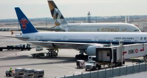 An Etihad Airways jet at John F Kennedy International Airport in New York.  Passengers travelling to the US from 10 airports in eight Muslim-majority countries will be prohibited from bringing large electronic devices on board. Photograph: Don Emmert/AFP/Getty Images