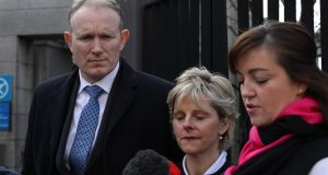 Gerard and Mary Costello, parents of Tadgh Costello  with  their solicitor Susie Elliott  outside the  Four Courts   on Tuesday. Photograph: Collins Courts