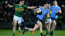 Eric Lowndes gets away from Kerry's Adrian Spillane in Tralee. Dublin emerged from a feral atmosphere with their record intact. Photograph: Cathal Noonan/Inpho