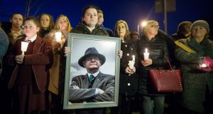 Roise Morgan holds an image of Martin McGuinness during a vigil in Belfast. Photograph: Liam McBurney/PA Wire