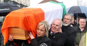 The coffin of Northern Ireland's former deputy first minister and ex-IRA commander Martin McGuinness is carried to his home in Derry by Gerry Adams, Raymond McCartney and Michelle O'Neill. Photograph: Niall Carson/PA Wire
