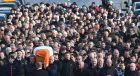 The remains of Martin McGuinness are carried by friends, colleagues and relatives through the streets of the Bogside in Derry. Photograph: Colm Lenaghan/Pacemaker Press