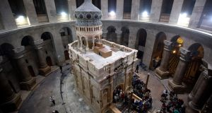 The tomb of Jesus Christ with the rotunda is seen in the Church of the Holy Sepulchre on Tuesday in Jerusalem, Israel. Photograph:   Lior Mizrahi/Getty Images