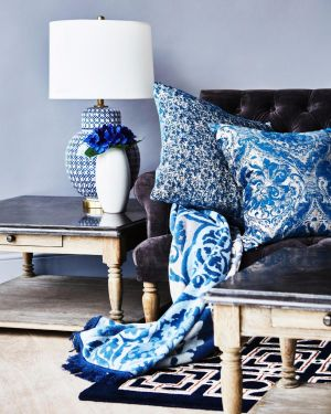Designer Paul Costello has been inspired by the Middle East for his new SS17 Living collection for Dunnes Stores (dunnesstores.com). This arabesque lamp, €175; Laurence side table, €400, matching coffee table, €700; Anton couch, €1000; Louis and Malibu cushions, €50 each; arabesque throw, €75, and Lattice rug, €150.