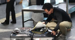 A man opens his luggage and to show his electronic equipment at security point at the Ataturk Airport in Istanbul, Turkey. The United States and Britain have banned some electronic devices from carry-on baggage on flights coming from a number of countries. Photograph: Sedat Suna/EPA.