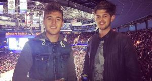 Canadian dream: Billy Lane, with his friend Simon McAuliffe, at a Vancouver Canucks ice-hockey game