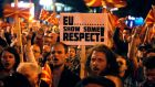 People protest in front of the parliament building in Skopje, Macedonia, on Tuesday, against the visit of EU enlargement commissioner Johannes Hahn and the bloc's support for a proposed multi-ethnic coalition government. Photograph: Boris Grdanoski/AP