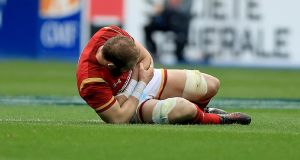 Alun Wyn Jones of Wales goes down injured during their Six Nations clash with France on Saturday. Photo: Donall Farmer/Inpho